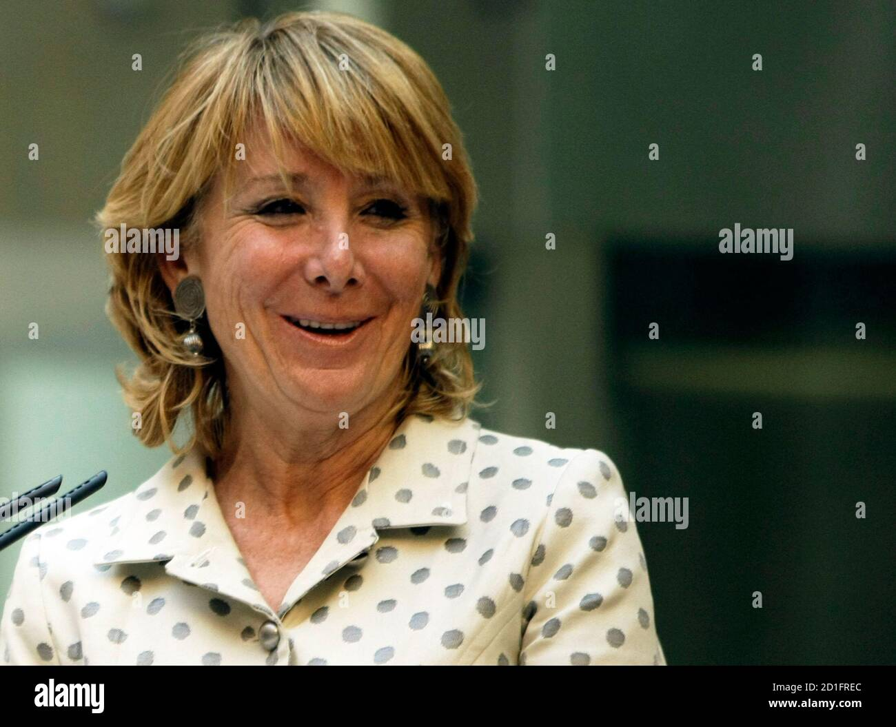 Esperanza Aguirre, Madrid regional president, smiles during a news conference in the regional headquarters of the Popular Party in central Madrid November 27, 2008. Aguirre explained how she escaped unhurt from the lobby of Mumbai's Trident-Oberoi hotel when Islamist militants fired automatic weapons indiscriminately and threw grenades before settling in for a long siege at the Taj and the Trident-Oberoi hotels.  REUTERS/Sergio Perez  (SPAIN) Stock Photo