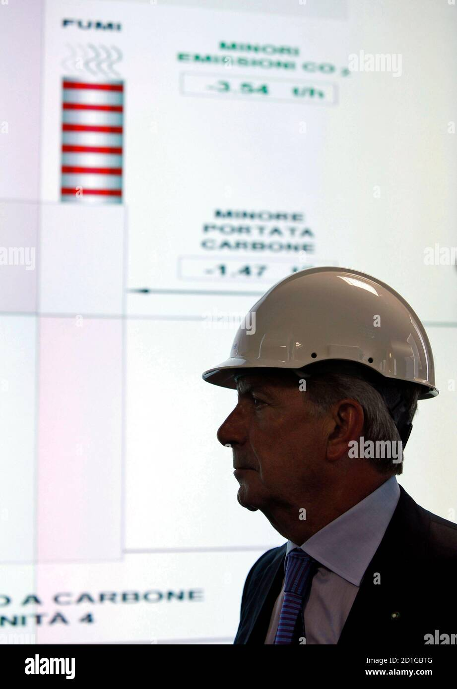 Enel SpA CEO Fulvio Conti looks on in the control room of the new hydrogen-fuelled combined cycle power plant inside the Andrea Palladio Fusina plant in Venice July 12, 2010. Italy's largest utility Enel SpA <ENEI.MI> aims to start converting a major oil-fuelled power plant to use clean coal technology next year as part of its drive to cut carbon emissions, Conti said on Monday. REUTERS/Alessandro Garofalo (ITALY - Tags: BUSINESS ENERGY) Stock Photo