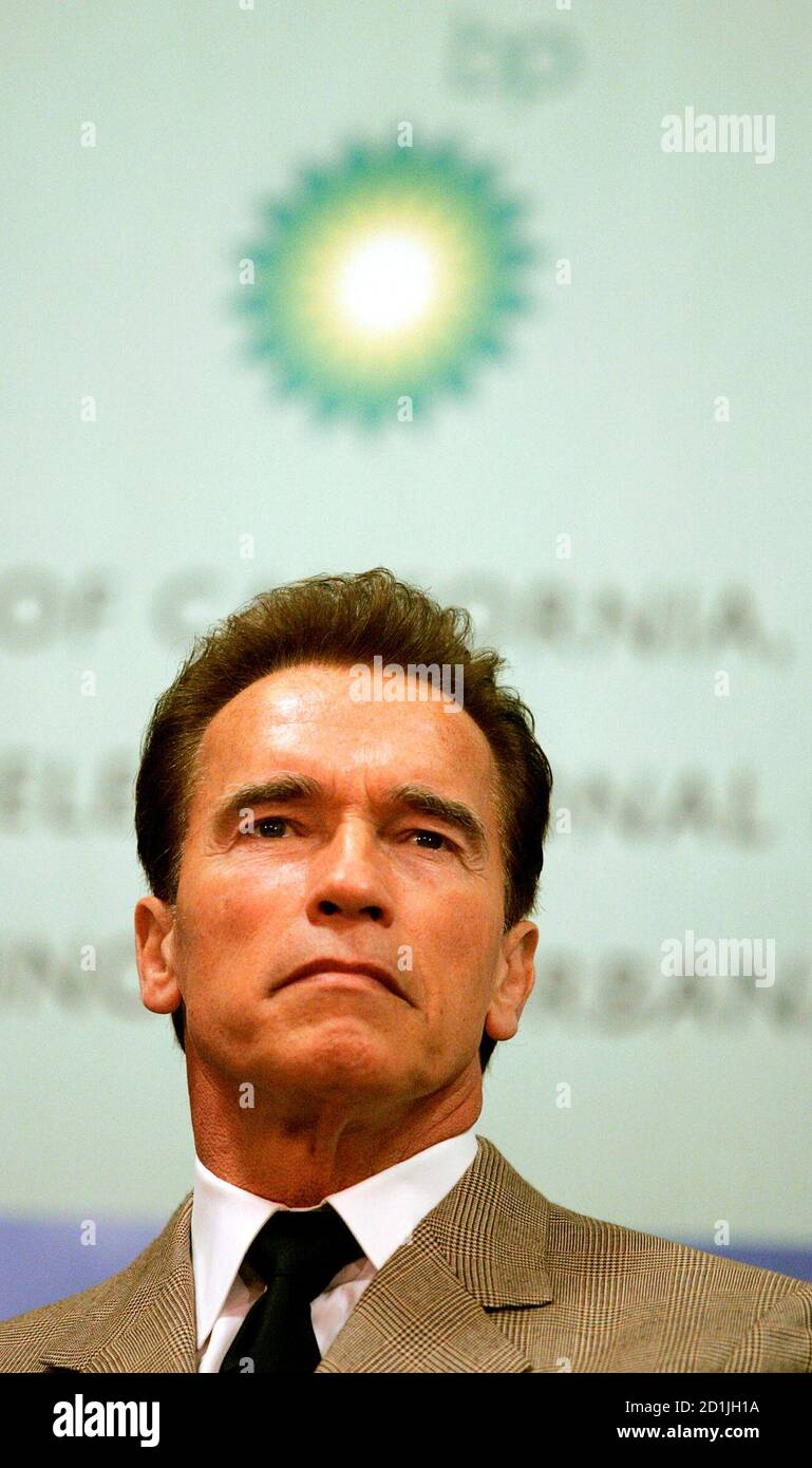 California Governor Arnold Schwarzenegger sits during a press conference in Berkeley, California February 1, 2007. British oil major BP Plc on Thursday announced that universities in California and Illinois will join company scientists in a $500 million energy research program focused on cleaner, alternative fuels.  REUTERS/Kimberly White (UNITED STATES) Stock Photo