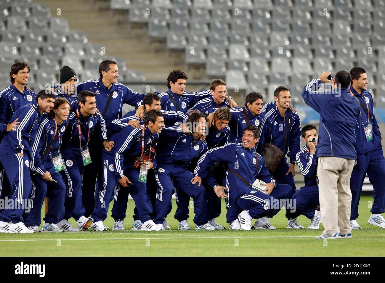 Members of Paraguay's national soccer team pose for a group picture during a visit to the Green Point stadium in Cape Town June 13, 2010.  REUTERS/Carlos Barria (SOUTH AFRICA - Tags: SPORT SOCCER WORLD CUP) Stock Photo