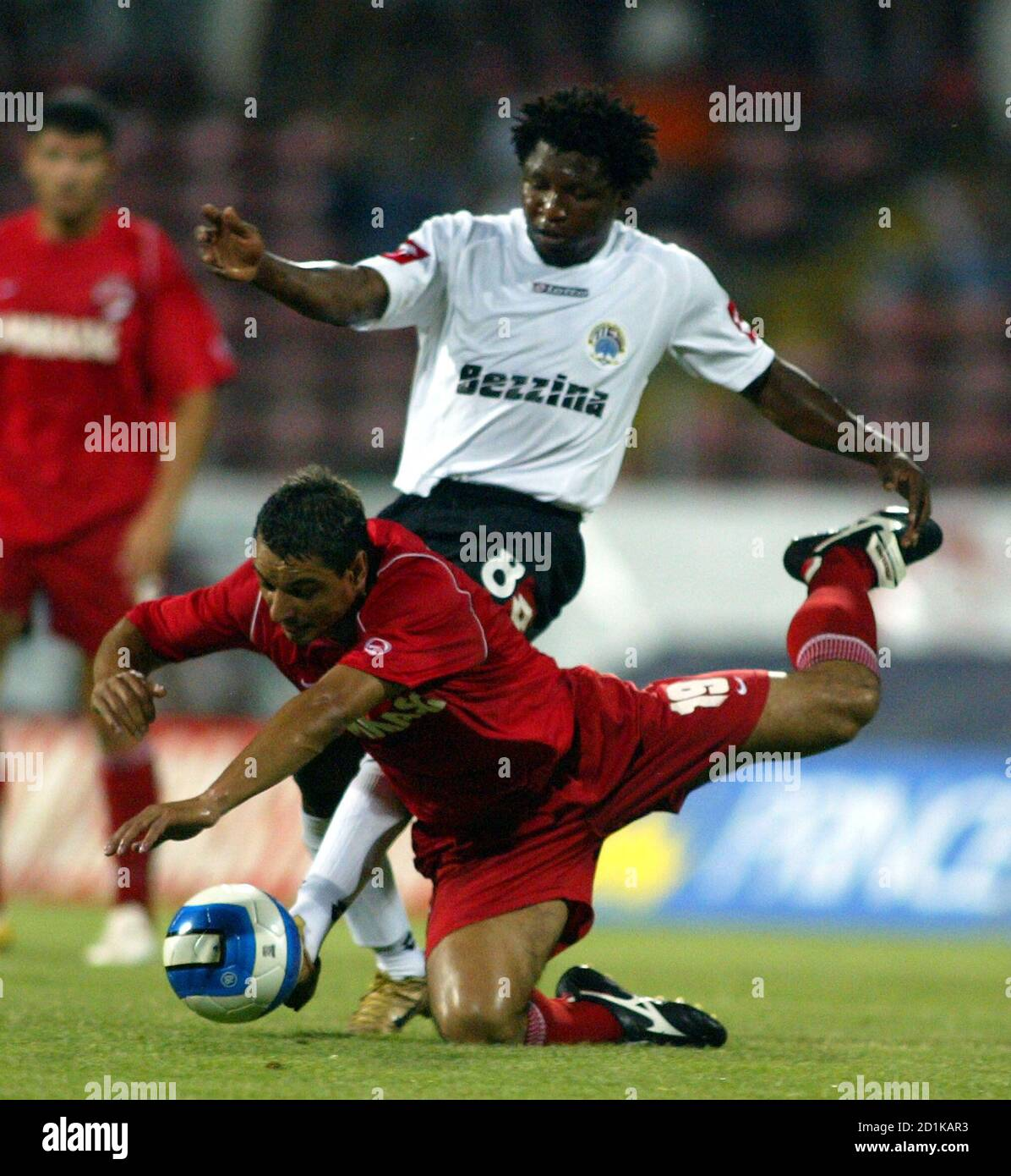 Dinamo Bucharest's Ionel Ganea falls in front of Hibernians' Ndubisi Chukunyere during their UEFA Cup first qualifying round second leg soccer match in Bucharest July 27, 2006.   REUTERS/Mihai Barbu (ROMANIA) Stock Photo