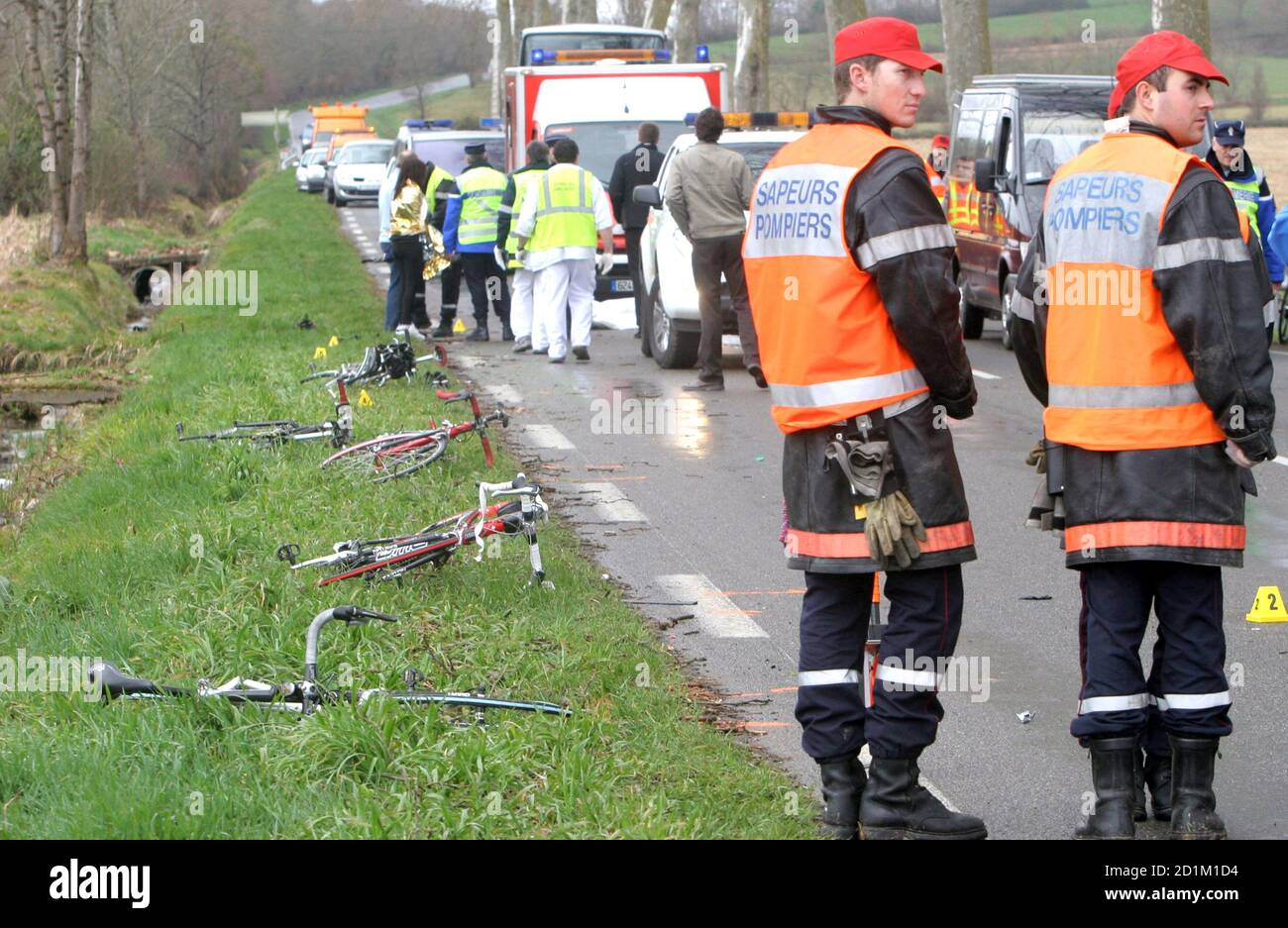 Emergency services gather at the scene of an accident where a car hit a group of 10 cyclists in Villecomtal sur Arros in southwestern France, March 8, 2009. At least one cyclist was killed and the others injured in the accident.    REUTERS/Laurent Dard  (FRANCE DISASTER) Stock Photo