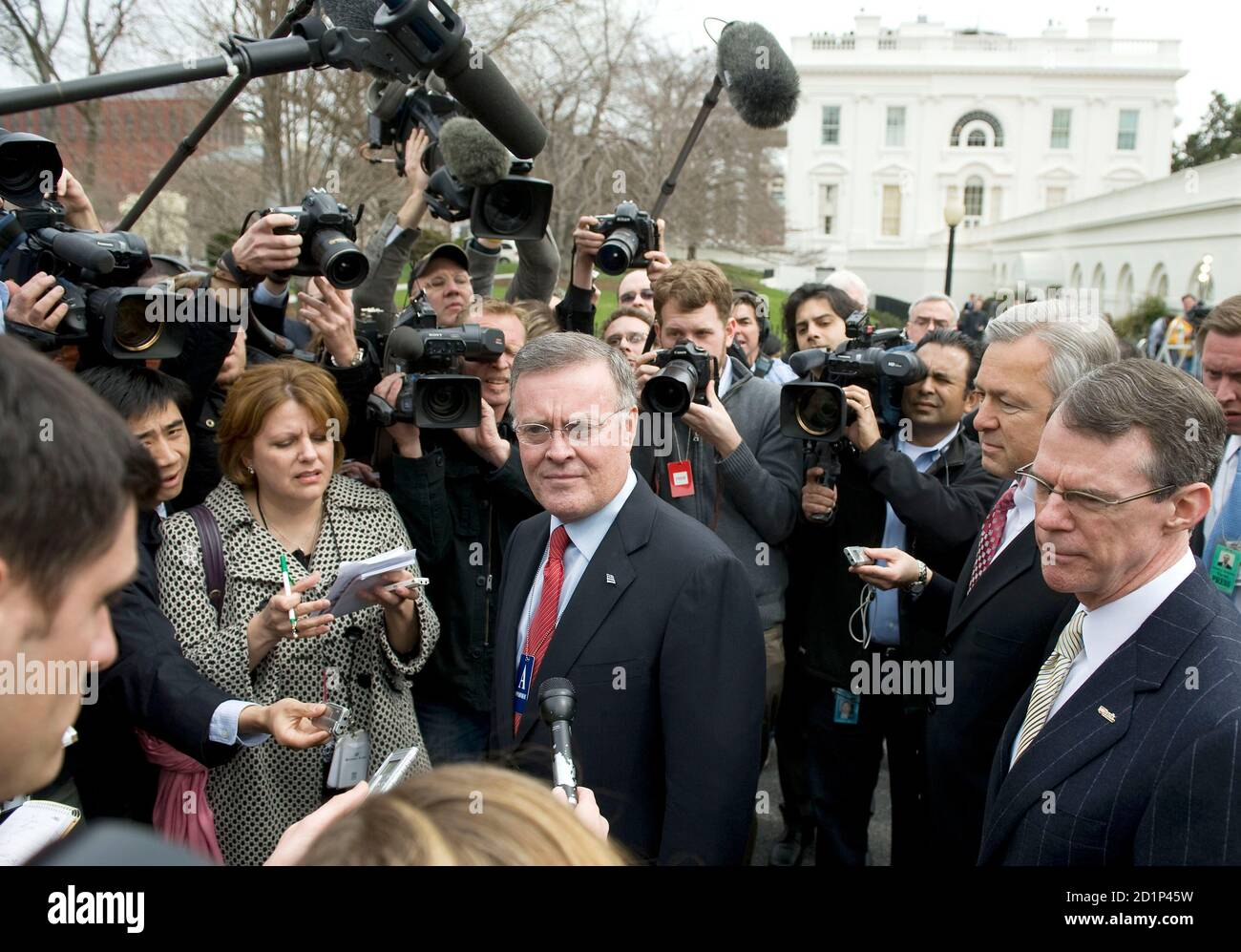 Bank of America Corp. Chief Executive Kenneth Lewis speaks to reporters at the White House after a meeting about the economy with U.S. President Barack Obama in the State Dining Room in Washington, March 27, 2009. Behind him are US Bancorp. Chief Executive Richard Davis (R) and Wells Fargo's Chief Executive John Stumpf (2nd R). Obama meets with top U.S. bankers on Friday to hash out plans to reform Wall Street, rid financial institutions of bad debts and jumpstart lending in an effort to pull the United States out of recession.  REUTERS/Larry Downing   (UNITED STATES POLITICS BUSINESS) Stock Photo