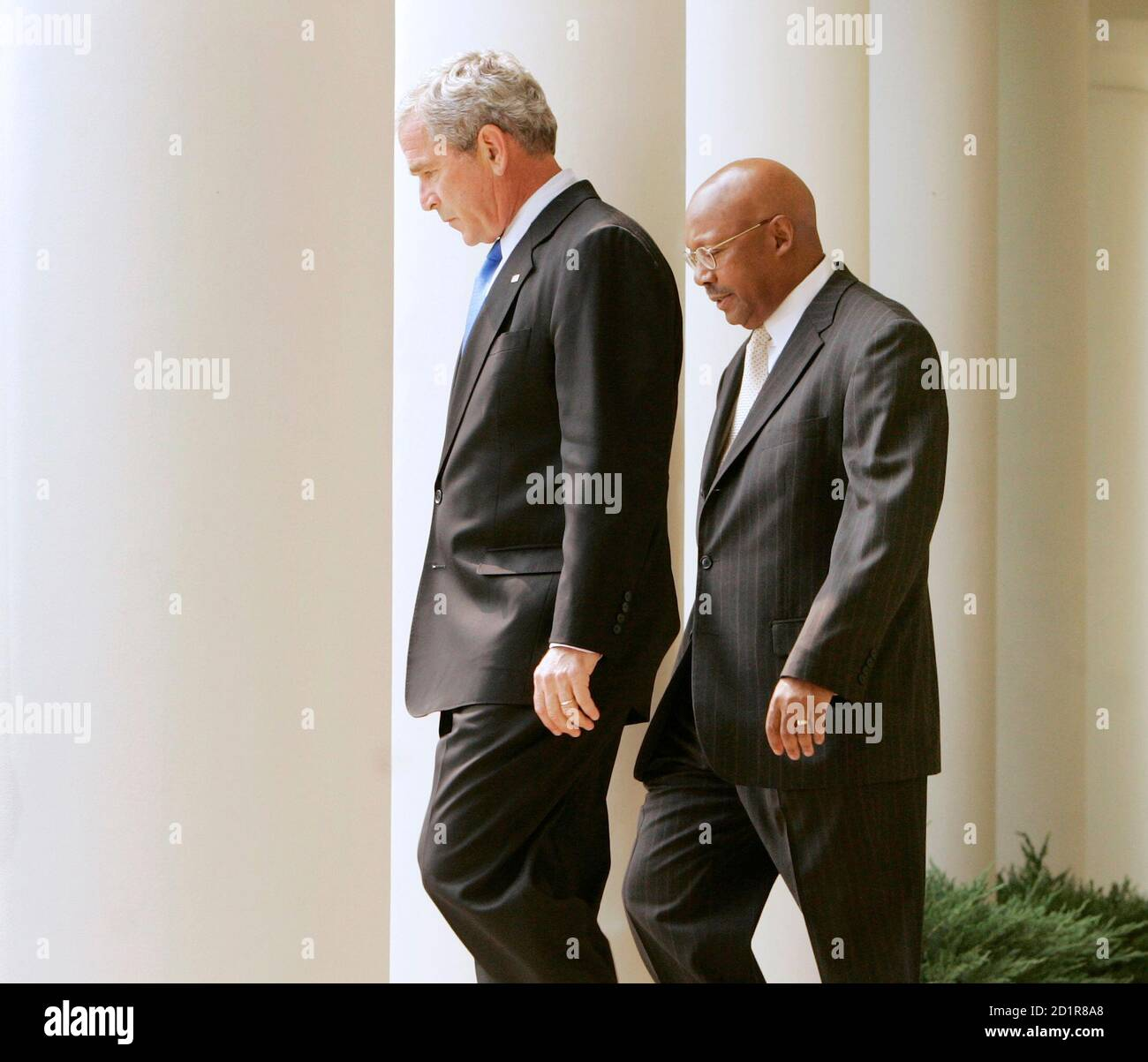U.S. President George W. Bush (L) walks out to talk about easing the mortgage default crisis with U.S. Secretary of HUD Alphonso Jackson (R) in the Rose Garden of White House in Washington August 31, 2007.    REUTERS/Larry Downing    (UNITED STATES) Stock Photo