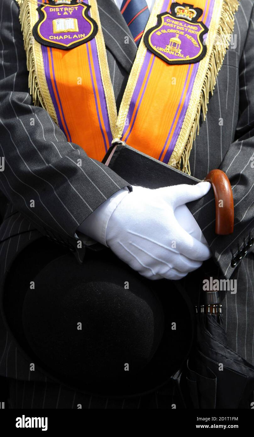 A member of the Orange Order holds his Bible during the annual protest outside Drumcree Church, as the Orange Order are prohibited from walking back to their Lodge headquarters along the Nationalist Garvaghy Road in Portadown July 4, 2010. The Orange Order has been banned from going down this road since 1998, due to violent confrontations that had previously broken out between the marchers and the Nationalists. REUTERS/Cathal McNaughton (NORTHERN IRELAND - Tags: CIVIL UNREST RELIGION) Stock Photo