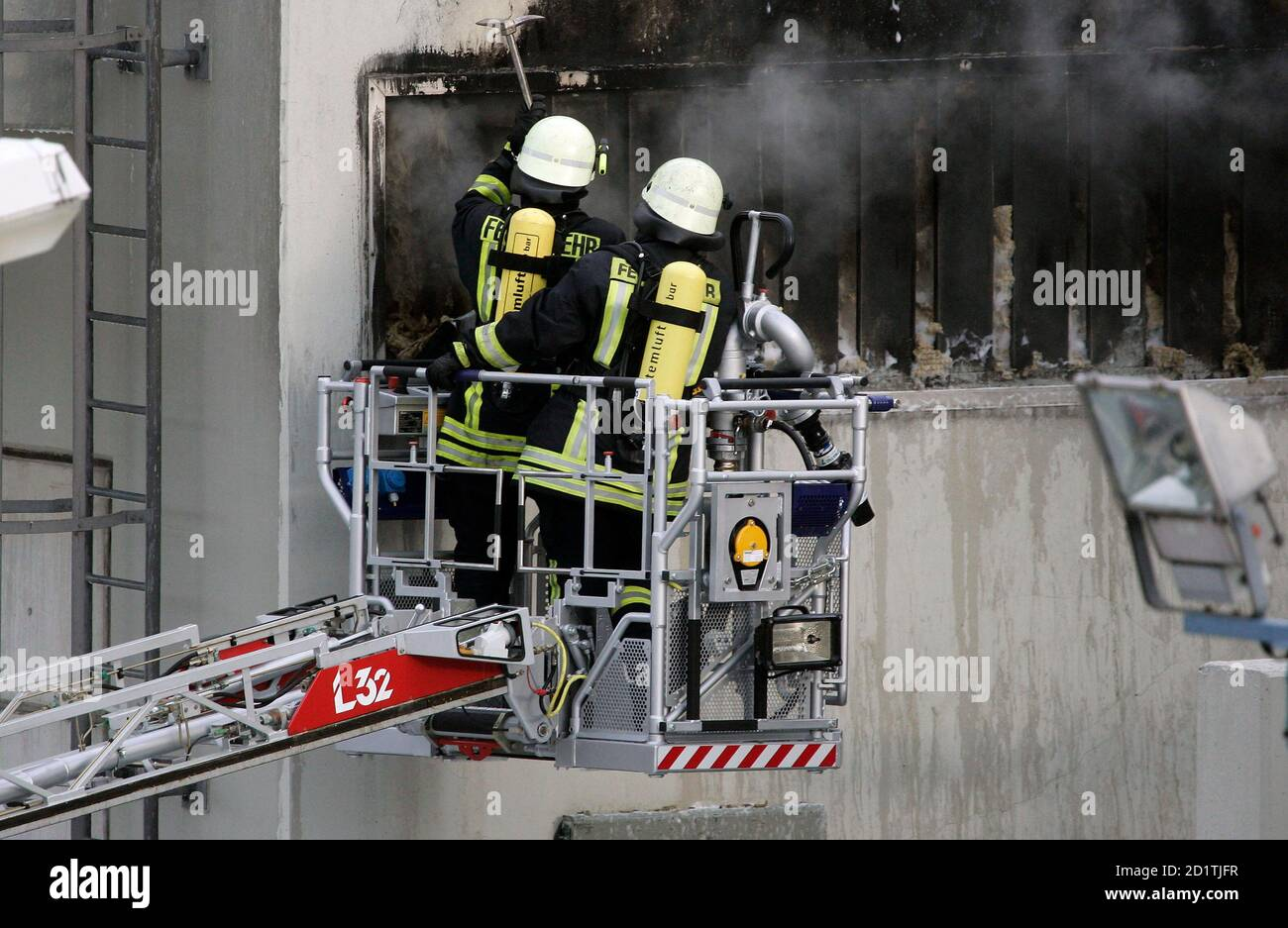 Firefighters check the fire area after extinguishing a fire at a transformer station on the site of the nuclear power plant Kruemmel near Geesthacht June 28, 2007. A fire broke out close to a nuclear plant in northern Germany on Thursday but police said the Kruemmel reactor, located about 30 km (20 miles) south-east of Hamburg, was unaffected.   REUTERS/Morris Mac Matzen (GERMANY) Stock Photo