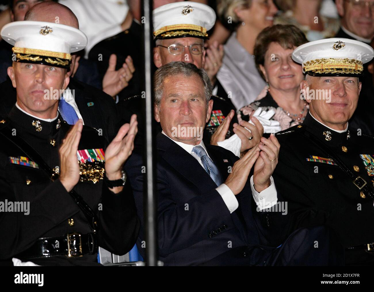 U.S. President George W. Bush (C) applauds with Gen. James Conway, Commandant of the Marine Corps, and Col. Andrew H. Smith (L), Commanding Officer of the Marine Barracks of Washington, during an Evening Parade at the Marine Barracks in Washington August 29, 2008. REUTERS/Yuri Gripas  (UNITED STATES) Stock Photo