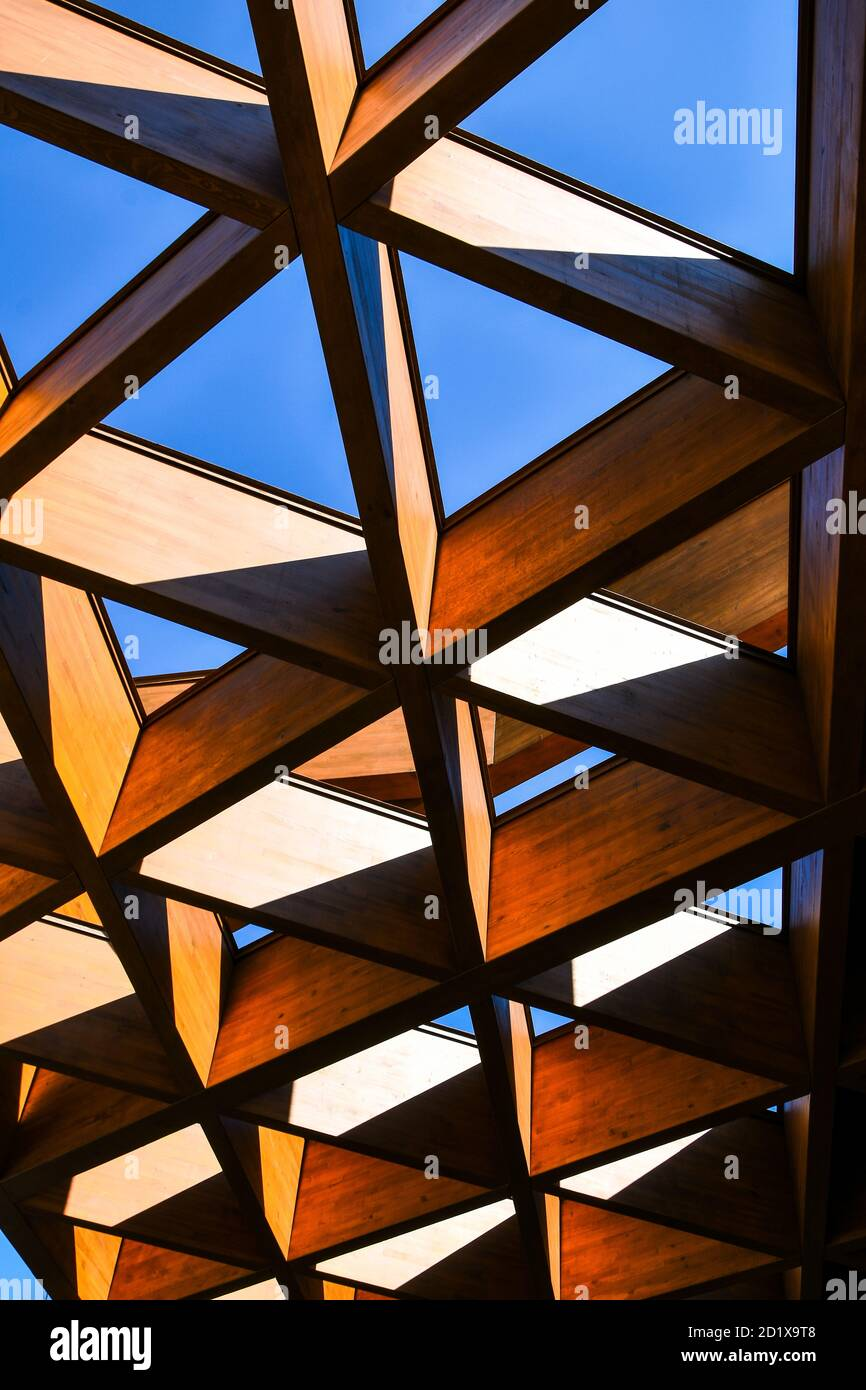 Roofing Construction. Wooden Roof Frame House Construction. Abstract Structure background. Wood texture pattern. Stock Photo