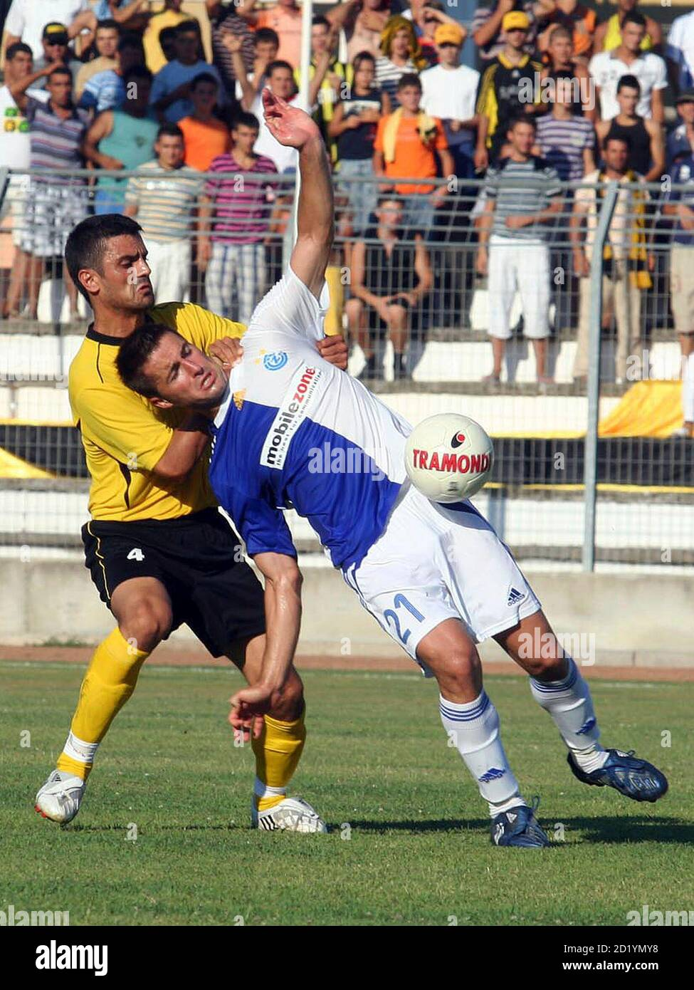 Altin Lilaj (L) of Albania's Besa fights for the ball with Samel Sabanovic of Switzerland's Grasshoppers during their second round, second-leg Intertoto Cup soccer match at Niko Dovana stadium in Durres, about 40 km (25 miles) from the capital Tirana, July 12, 2008. REUTERS/Arben Celi (ALBANIA) Stock Photo