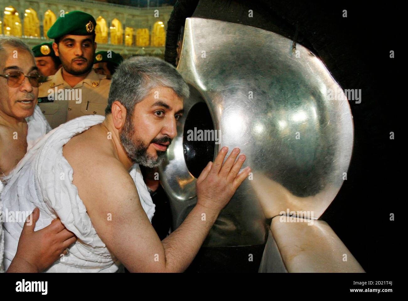 hamas-leader-khaled-meshaal-prays-in-front-of-the-black-stone-inside-the-kaaba-in-the-grand-mosque-in-mecca-early-february-9-2007-rival-palestinian-factions-signed-a-deal-to-form-a-unity-government-hoping-to-end-bloodshed-between-their-followers-and-to-win-back-western-aid-halted-because-of-the-hostility-of-hamas-to-israel-reuterssuhaib-salem-saudi-arabia-2D21T4J.jpg
