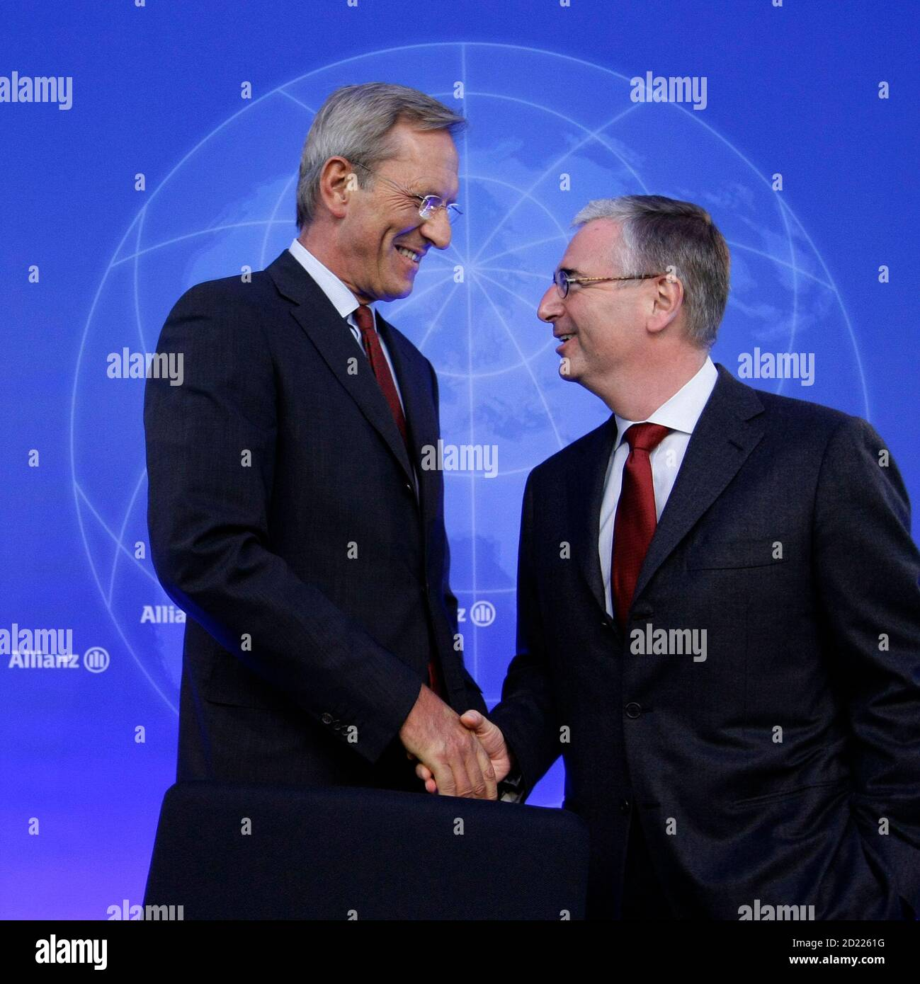 Michael Diekmann (L), CEO of Europe's biggest insurer Allianz SE, greets his Chief Financial Officer (CFO) Paul Achleitner before their company's annual news conference in Munich February 25, 2010. Allianz Group today reported solid results for fiscal year 2009, despite a challenging global economy. Based on preliminary figures, total revenues grew 5.2 percent to 97.4 billion euros for the year.  REUTERS/Michaela Rehle (GERMANY) Stock Photo