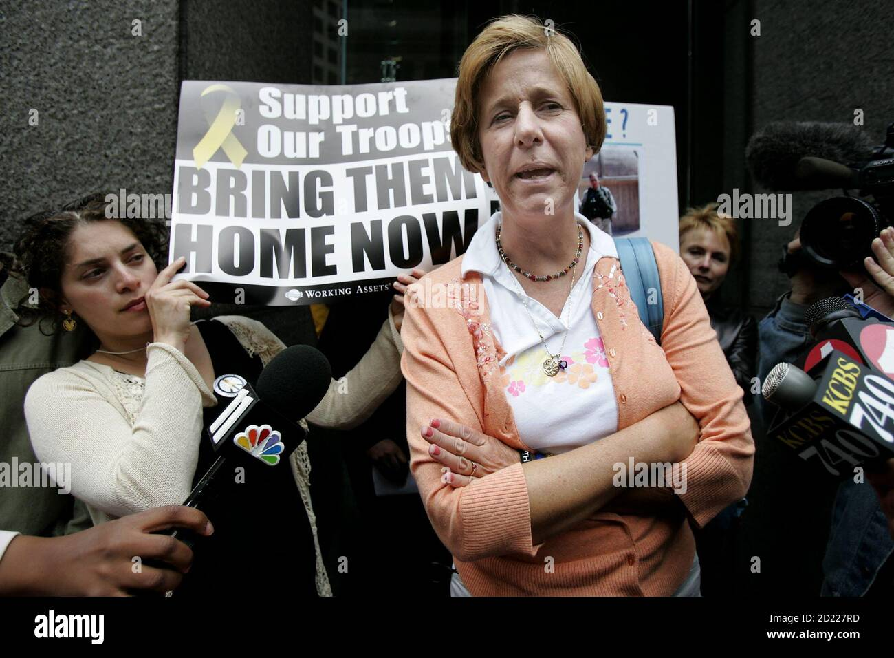 Iraq war protester Cindy Sheehan (R) speaks to the media outside the office of Senator Dianne Feinstein in San Francisco, California, September 9, 2005. Sheehan, who says her focus now will be Congress, met with staff of Senator Feinstein to discuss the war in Iraq. REUTERS/Kimberly White  KW Stock Photo