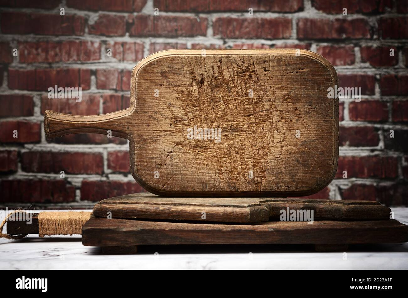 Very Old Vintage Rectangular Kitchen Cutting Board Against Brown Brick Wall Background Stock Photo Alamy