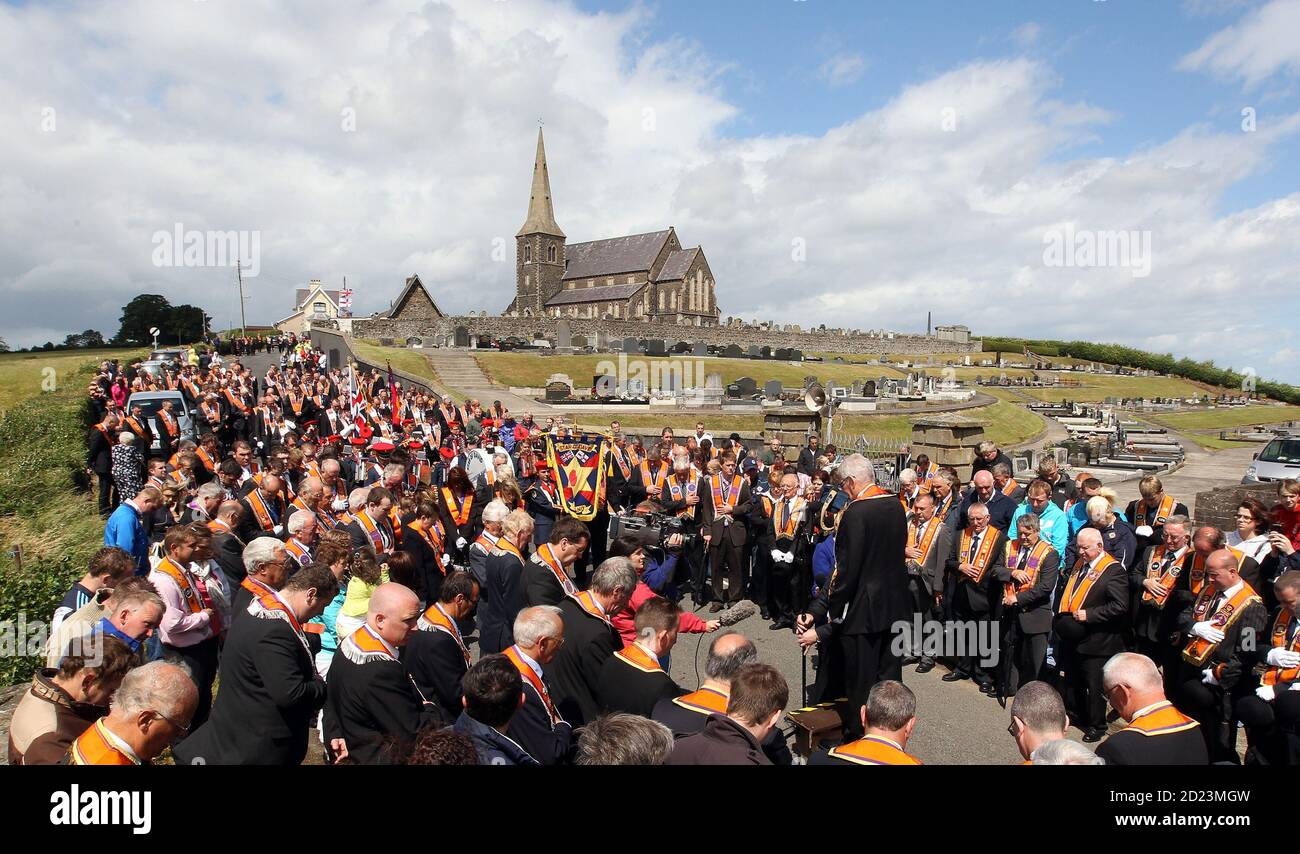 Members of the Orange Order hold their annual protest outside Drumcree Church, as they are prohibited from walking back to their Lodge headquarters along the Nationalist Garvaghy Road, in Portadown July 4, 2010. The Orange Order has been banned from going down this road since 1998, due to violent confrontations that had previously occurred between the marchers and the Nationalists. REUTERS/Cathal McNaughton (NOR RN IRELAND - Tags: CIVIL UNREST RELIGION IMAGES OF THE DAY) Stock Photo