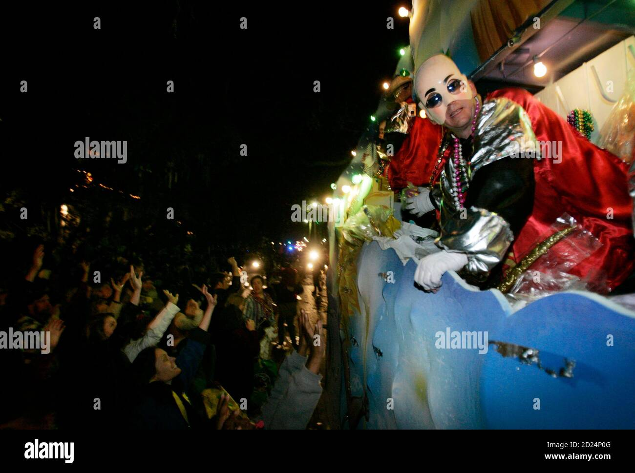 Members of the Krewe of Bacchus parade down St. Charles Avenue while celebrating the Mardi Gras weekend in New Orleans, Louisiana on February 18, 2007. REUTERS/Sean Gardner (United States) Stock Photo
