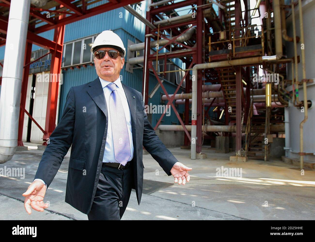 Enel SpA CEO Fulvio Conti gestures as walks during the inauguration of the new hydrogen-fuelled combined cycle power plant inside the Andrea Palladio Fusina plant in Venice July 12, 2010. Italy's largest utility Enel SpA aims to start converting a major oil-fuelled power plant to use clean coal technology next year as part of its drive to cut carbon emissions, Conti said on Monday.  REUTERS/Alessandro Garofalo (ITALY - Tags: ENERGY BUSINESS) Stock Photo