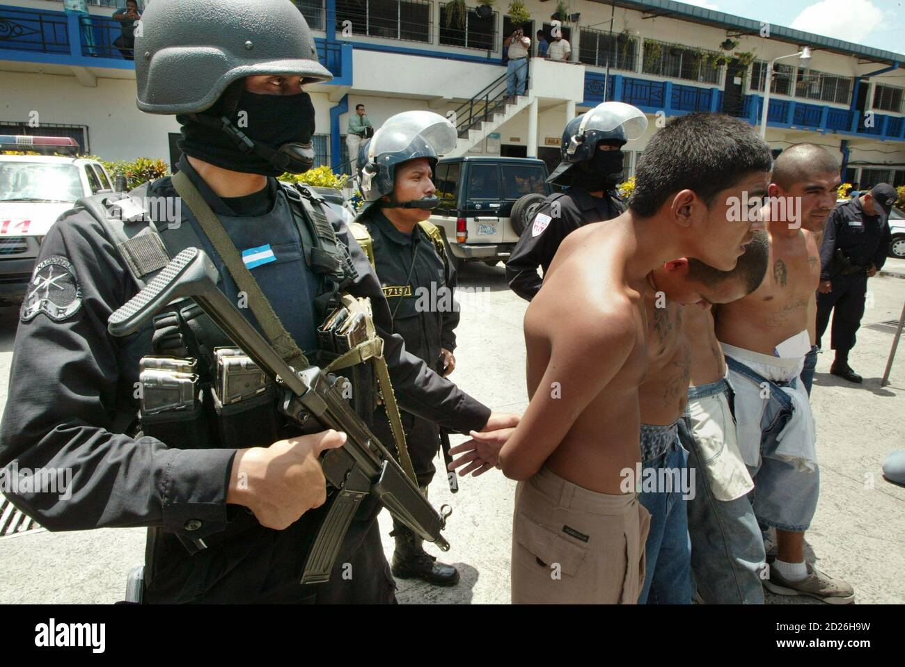 Gang members are escorted after being captured by riot police in San Salvador September 8, 2005. Authorities announced that the Simultaneous International Anti-Gang Operations in five different countries - Mexico, Guatemala, El Salvador, Honduras and the United States - have netted some 660 suspects. REUTERS/Luis Galdamez  LG/CCK Stock Photo