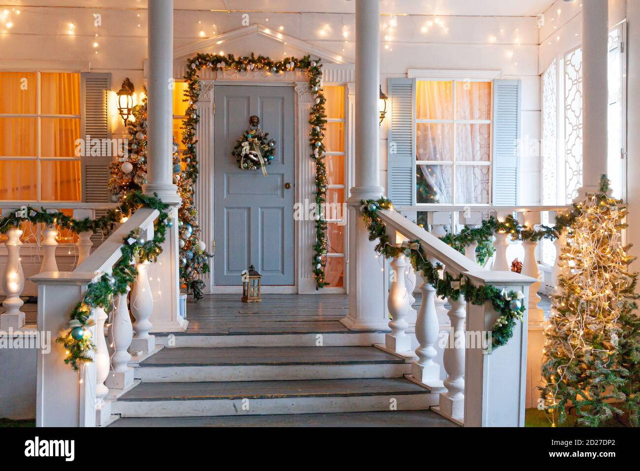 Christmas Porch Decoration Idea House Entrance Decorated For Holidays Golden And Green Wreath Garland Of Fir Tree Branches And Lights On Railing Christmas Eve At Home Stock Photo Alamy