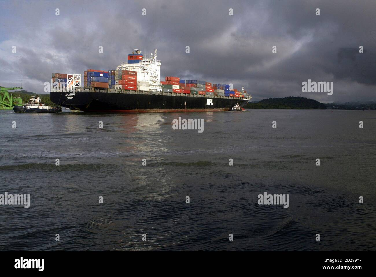 A cargo ship enters the Pacific entrance of the Panama Canal November 17, 2008. The Pacific and Atlantic entrances to the Canal will be dredged to a width of 225m and a depth of 15.5m to allow ships bigger than the current Panamax dimensions to travel through the third locks. REUTERS/Alberto Lowe (PANAMA) Stock Photo