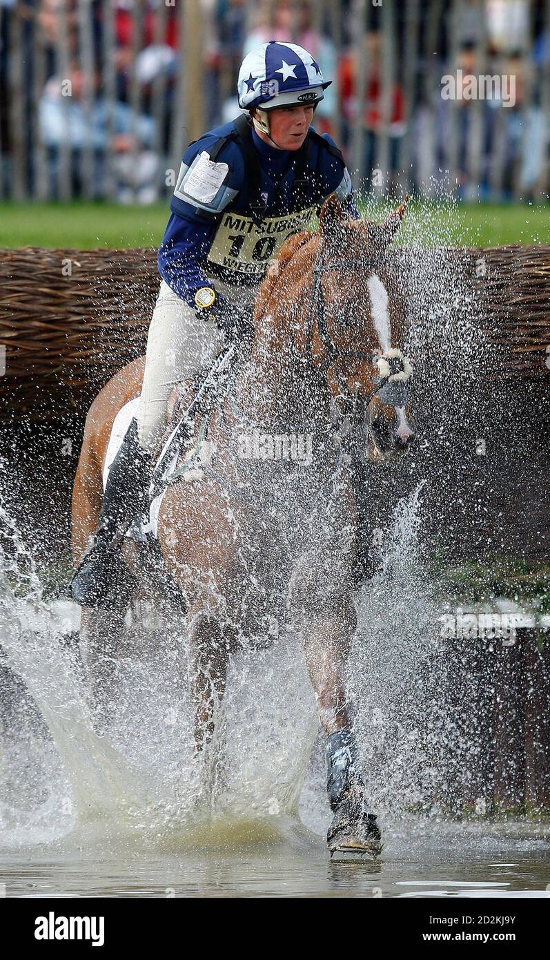 Britain's Lucy Wiegersma on Shaabrak jumps into the water during the cross country on the third day of The Badminton Horse Trials in Badminton, western England May 9, 2009.  REUTERS/Eddie Keogh (BRITAIN SPORT EQUESTRIANISM) Stock Photo