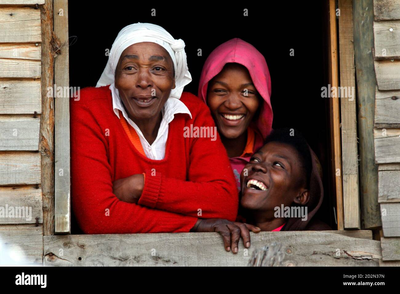 Residents look out a window in a local township in Knysna, near Cape Town June 13, 2010.    REUTERS/Charles Platiau (SOUTH AFRICA - Tags: SOCIETY) Stock Photo