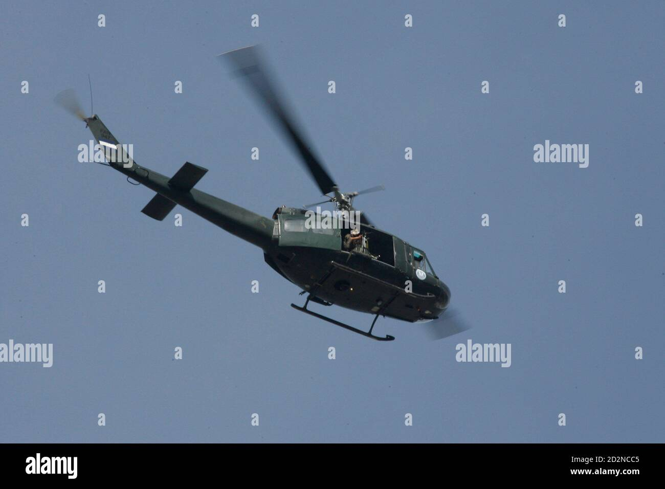 A Honduran army helicopter patrols overhead near the presidential residency in Tegucigalpa June 28, 2009. Witnesses said Honduras' President Manuel Zelaya was detained at home by troops in a constitutional crisis over his attempt to win re-election. CNN's Spanish-language channel later quoted Costa Rican officials as saying he was in Costa Rica and seeking political asylum. REUTERS/Oswaldo Rivas (HONDURAS POLITICS CONFLICT MILITARY) Stock Photo