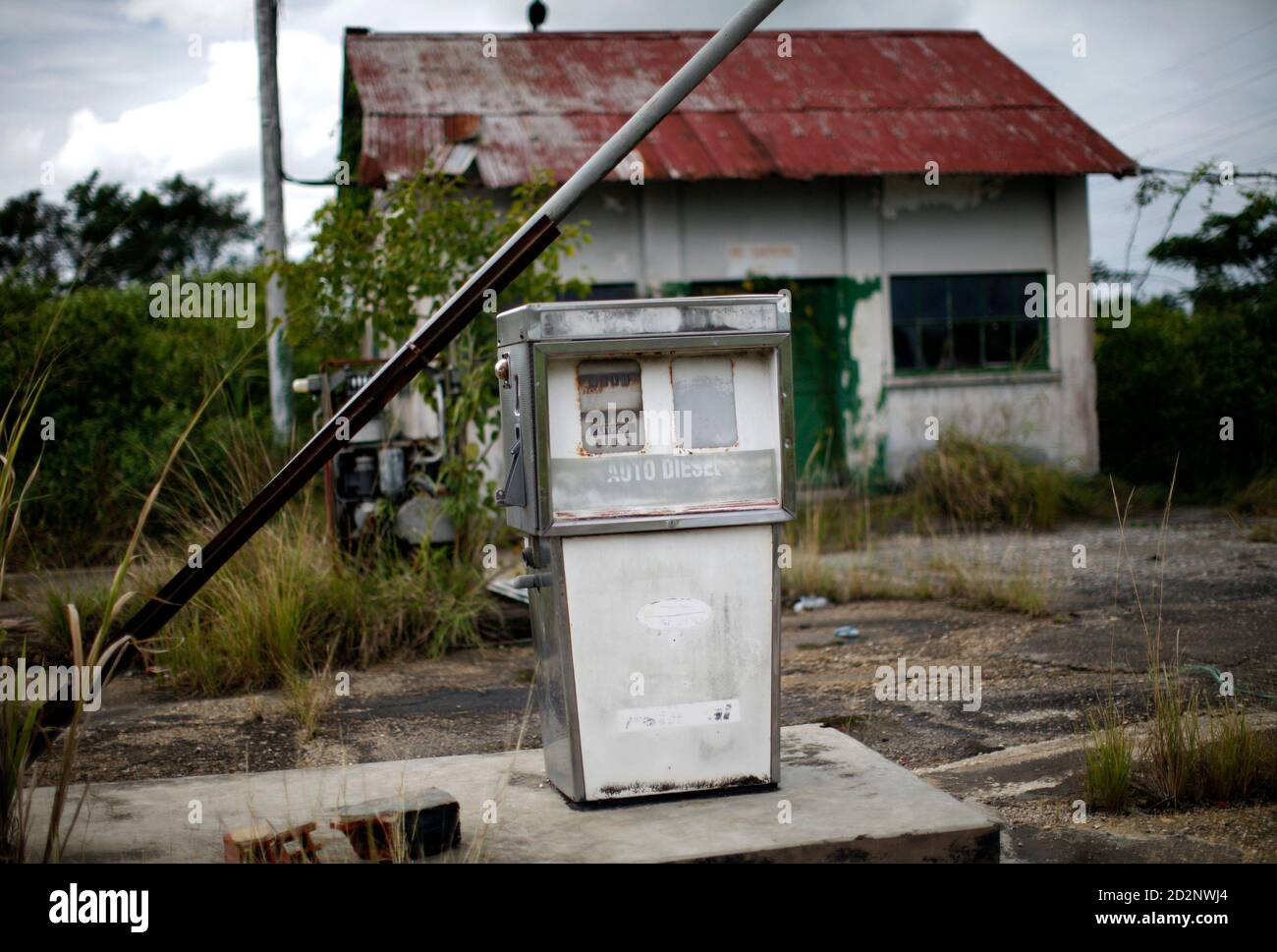 An Old Gas Pump Is Seen At An Abandoned Gas Station South Of Port Of Spain November 30 2009 Reuters Carlos Barria Trinidad And Tobago Energy Stock Photo Alamy