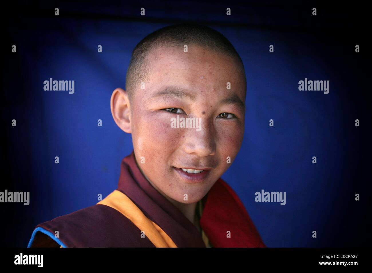 A Buddhist monk is seen at the court yard of Erdene Zeu monastery in Kharahorin, some 380 km (236 miles) west of Ulan Bator, July 8, 2006. The Erdene Zeu monastery was ransacked during the Stalinist period, and worship was forbidden throughout the Communist era, but Buddhism is experiencing a revival since Mongolia overthrew decades of Soviet dominance in 1991. Stock Photo