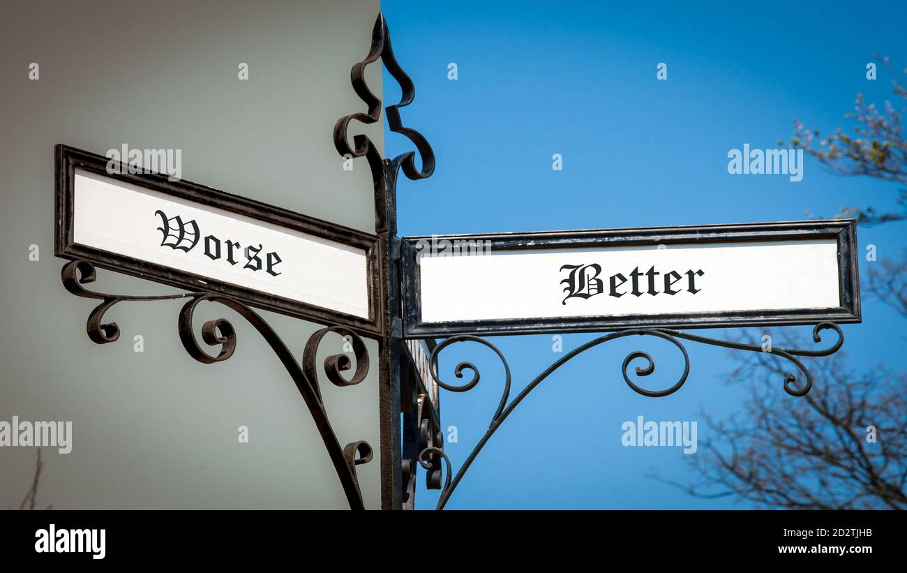 Street Sign the Direction Way to Better versus Worse Stock Photo