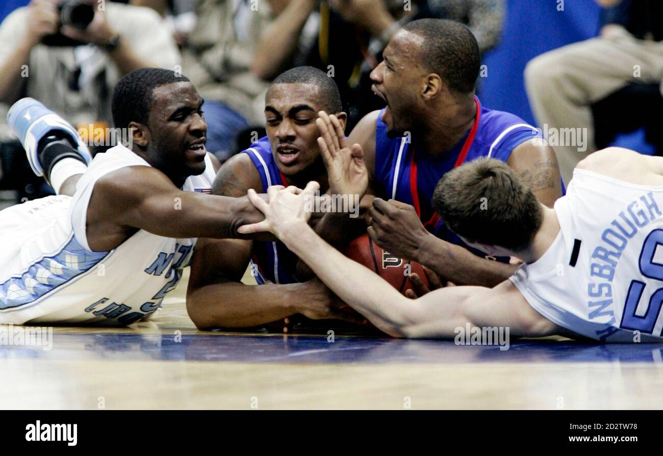 Kansas Jayhawks and North Carolina Tar Heel players scramble on the floor for a loose ball in the first half of their NCAA Men's Final Four semi-final basketball game in San Antonio, Texas, April 5, 2008. From left to right are: North Carolina's Ty Lawson, Kansas' Darrell Arthur, Kansas' Darnell Jackson and North Carolina's Tyler Hansbrough. Kansas recovered the ball on the play.   REUTERS/Jeff Haynes (UNITED STATES) Stock Photo
