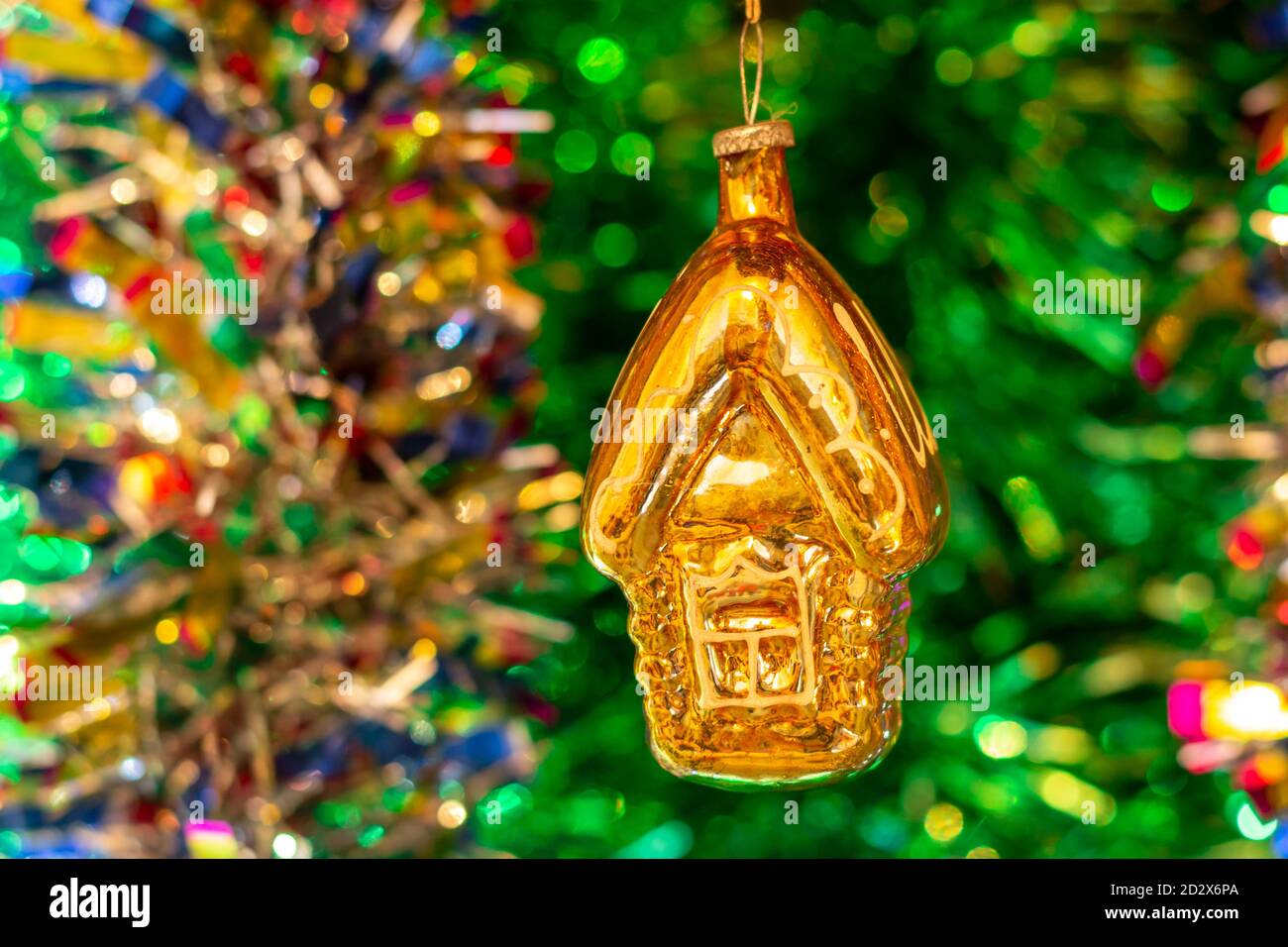Vintage Glass Soviet New Year S Toy House Against The Background Of A Christmas Tree And Colorful Bright Tinsel Stock Photo Alamy