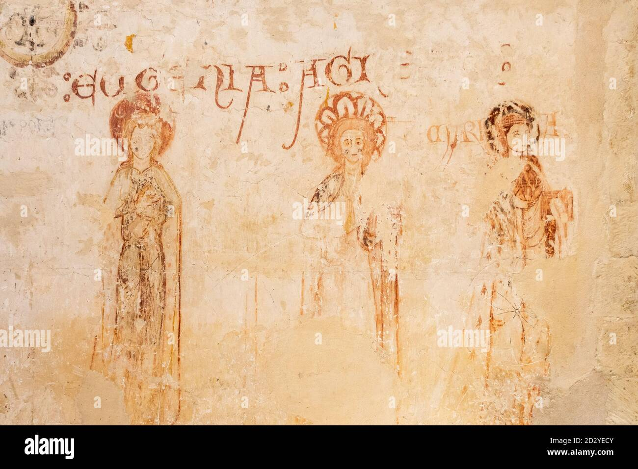 Early thirteenth century wall paintings of saints Eugenia, Agnes and Maria inside St Peters Church, Farnborough, Hampshire, UK Stock Photo