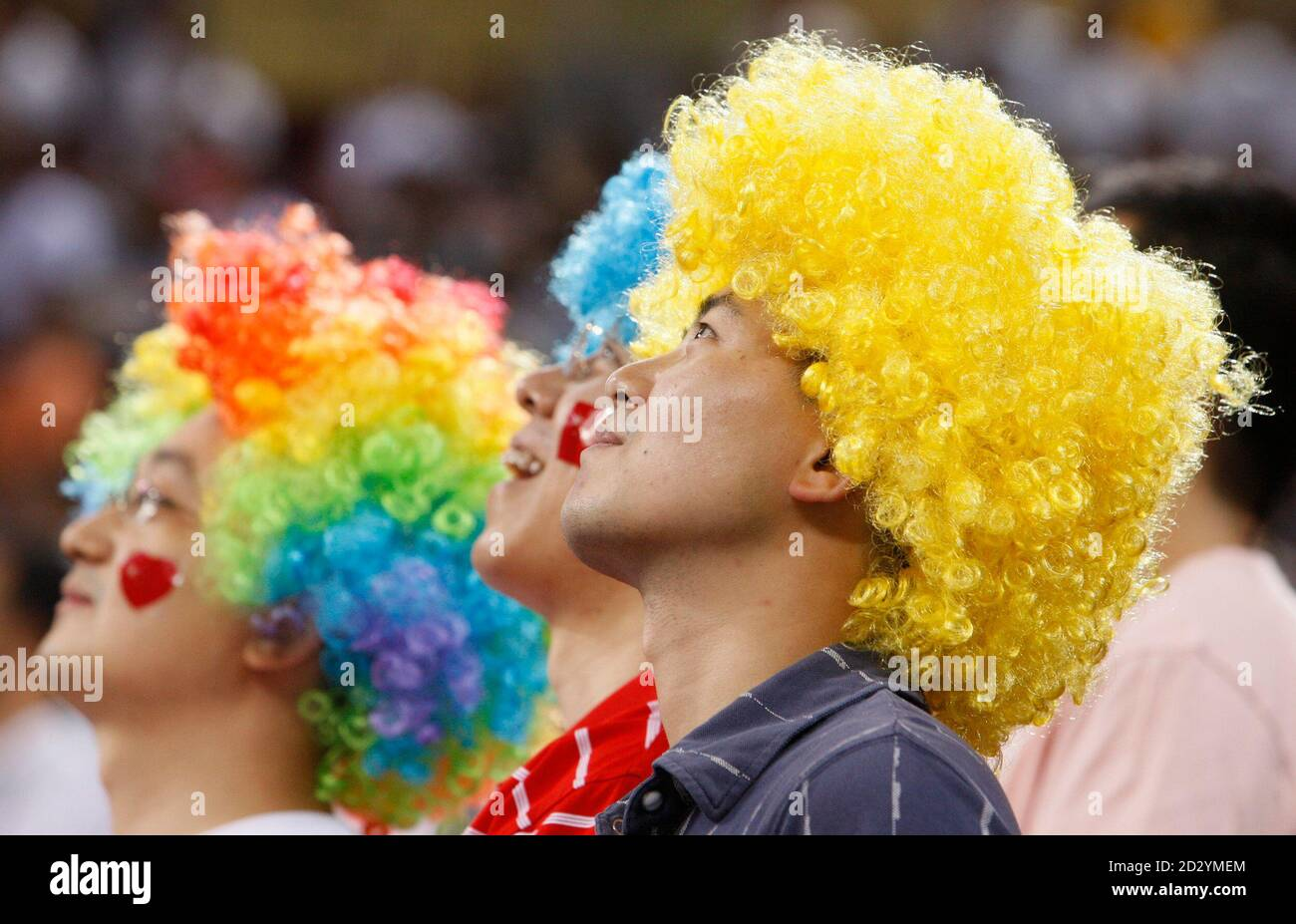 Fans Wear Bright Wigs At The Latvia South Korea Women S Group A Basketball Game During The Beijing 2008 Olympic Games August 17 2008 Reuters Lucy Nicholson China Stock Photo Alamy
