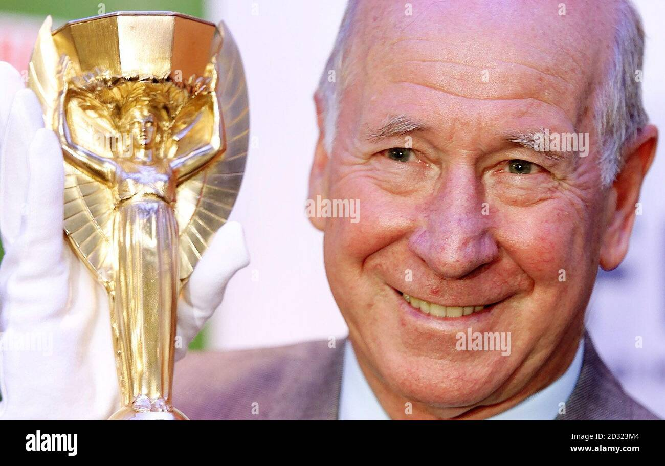 Sir Bobby Charlton one of England's 1966 winning heroes unveiled a replica of the World Cup trophy for the first time since it was commissioned. Sir Bobby,was presented with the 254,000 Jules Rimet trophy, at the National Football Museum, in Preston. * The trophy was ordered by the Football Association after the original was stolen three months before the tournament began, it was eventually discovered by a man out walking his dog and placed in a vault of a London jewellers until the final on July 30. But not since the players celebrated on the pitch at Wembley stadium, London, after being p Stock Photo