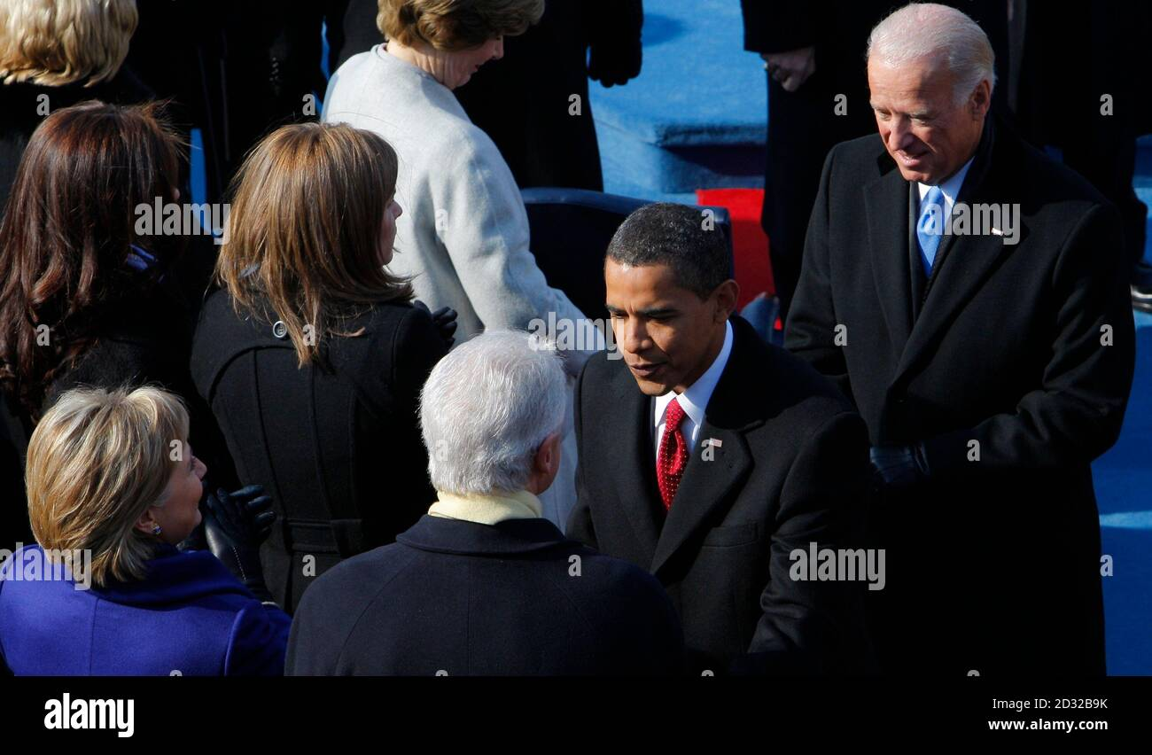 U.S. President-elect Barack Obama (2nd R) shakes hands with former President Bill Clinton (C) and his wife Hillary (bottom L) as Vice-President elect Joe Biden (R)  looks on ahead of the inauguration of  Obama as the 44th President of the United States at the inauguration ceremony in Washington, January 20, 2009. REUTERS/Brian Snyder (UNITED STATES) Stock Photo