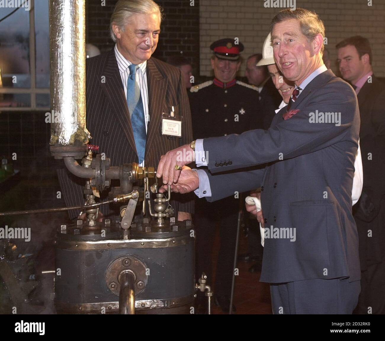 The Prince of Wales turns a valve to start the pumps,  during his visit to the Kempton Park Water Treatment Works in south west London, where he viewed a restored 62ft high engine which has been out of action for the past 20 years at the restored Pump House.   * The engines at Kempton's historic Pump House were the largest of their type in the UK, each operating 1,008 horse power with a crankshaft weighing 30 tons. Now that the restoration of the engine is complete, the  Kempton Great Engines plans to open the Pump House as a museum.  Stock Photo