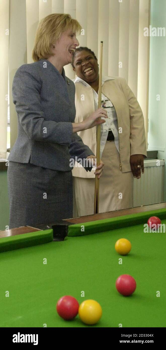 The Countess of Wessex tries her hand at pool watched by Mrs Maureen Earle, a bail support and remand officer, during her visit to the Caerphilly & Blaenau Gwent Youth Offending Team at Pontllanfraith, Gwent. Stock Photo