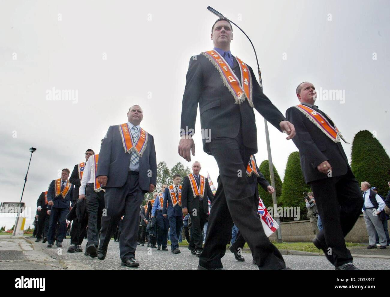 Portadown Orangemen marching through Portadown town prior to their Church service. For the sixth-year running the Orange Order has been blocked from returning through the staunchly Catholic Garvaghy Road following a service at Drumcree Parish Church.  *   on the edge of Portadown. Even though a new peace initiative was put forward which involved the order being allowed to walk down the flashpoint route in return for ending their ban on direct talks with the nationalist residents, it came too late to overturn this year's ruling by the Parades Commission.  Stock Photo
