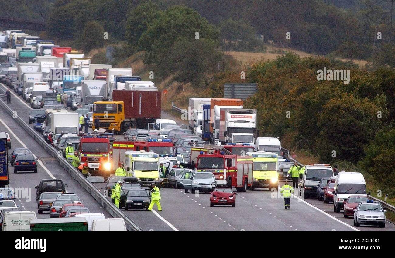 Emergency services crews attend the scene of a crash involving 12 vehicles on the northbound carriageway of the M5 motorway near Bristol. Up to a dozen people were injured in the accident, which happened between junctions 20 and 19 of the motorway shortly after 1pm. The cause of the crash was not yet known, but a police spokesman said there were reports of a heavy downpour at around the time of the incident.  Stock Photo