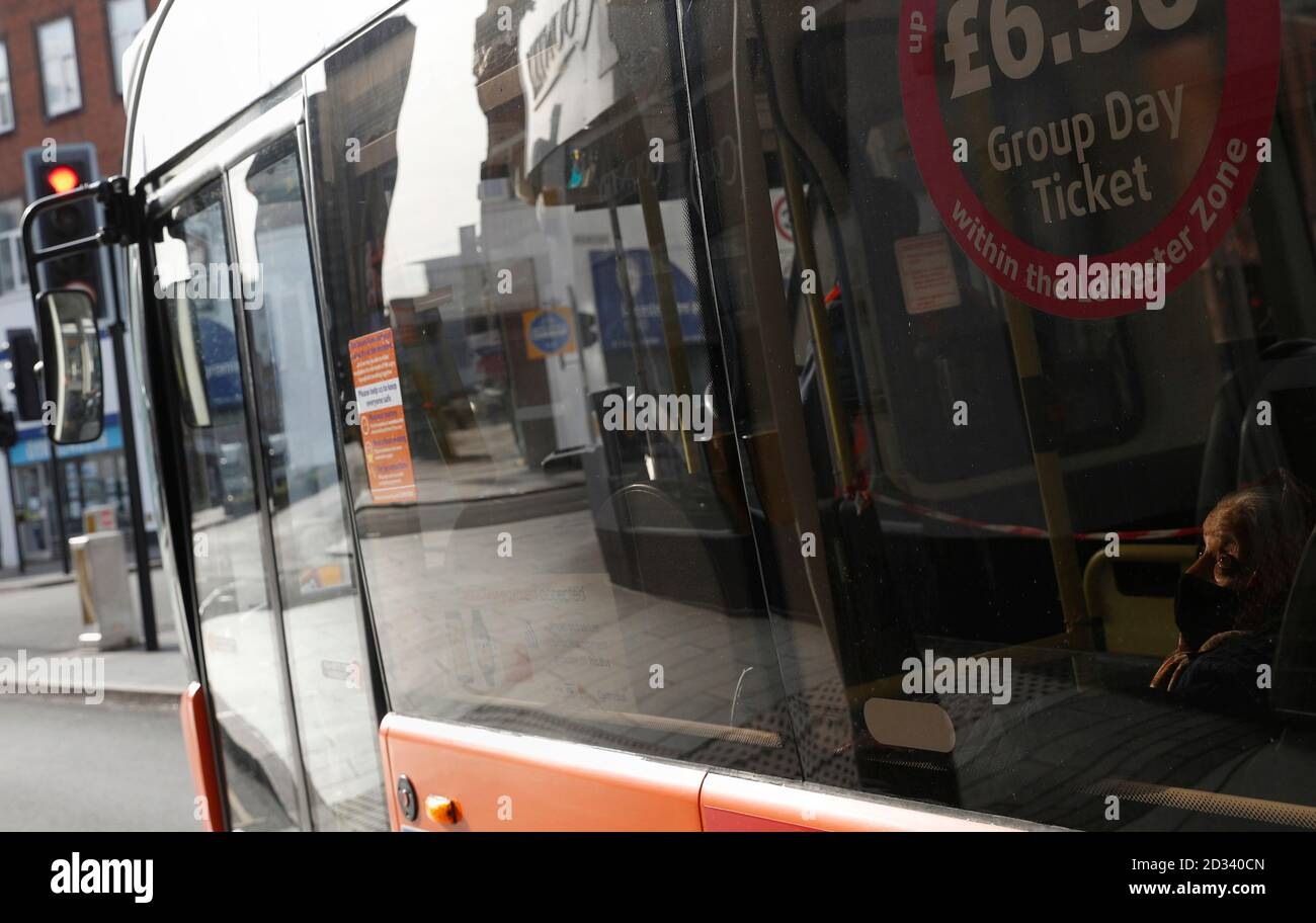 Leicester, Leicestershire, UK. 7th October 2020. A woman travels on a bus 100 days since the UKÕs first local coronavirus pandemic lockdown was announced in the city. Credit Darren Staples/Alamy Live News. Stock Photo