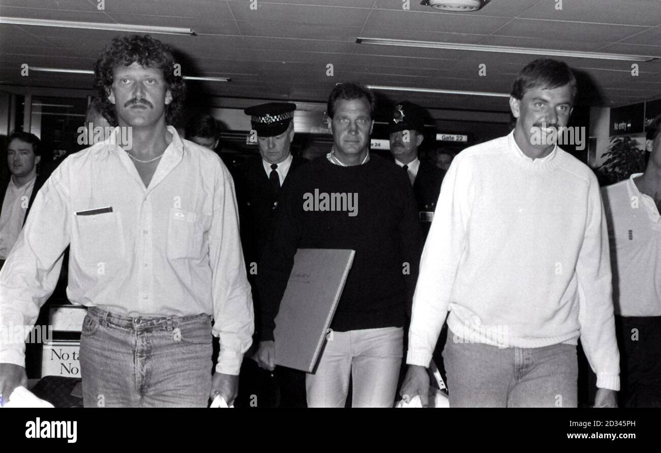 Members of the rebel cricket team at Heathrow Airport, returning home from South Africa. From Left: Richard Ellison, vice-captain John Emburey and player-manager David Graveney. Stock Photo