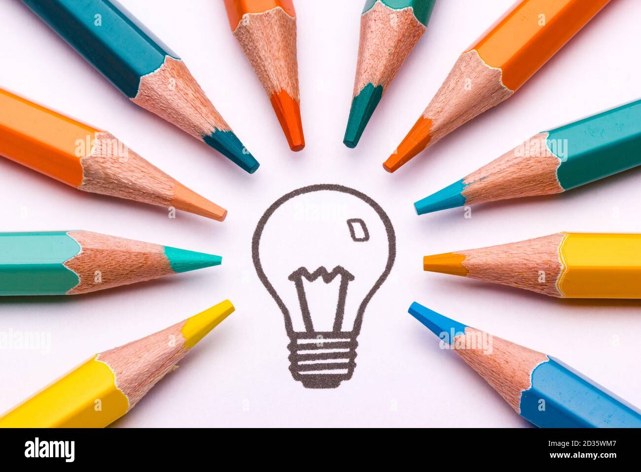 A light bulb surrounded by colour pencils as a symbol of creativity and art Stock Photo