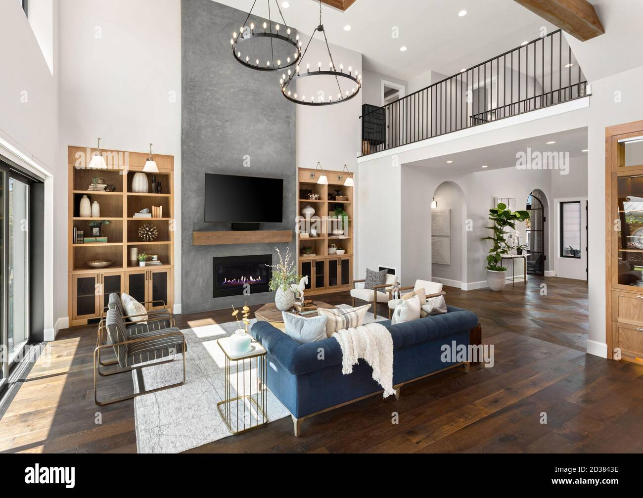 Beautiful Living Room In New Traditional Style Luxury Home Features Vaulted Ceilings Fireplace With Roaring Fire And Elegant Furnishings Stock Photo Alamy