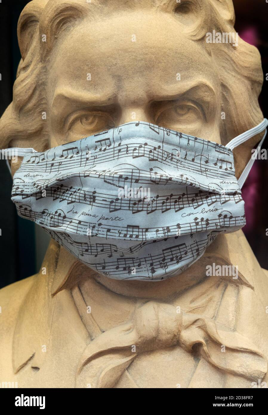 Beethoven statue bust wearing Covid Covid19 Corona face mask with musical score in Trier Germany 2020 Stock Photo