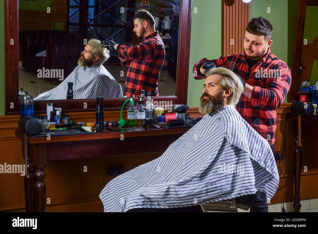 Hipster getting haircut. Man with dyed hair. Barber hairstyle ...