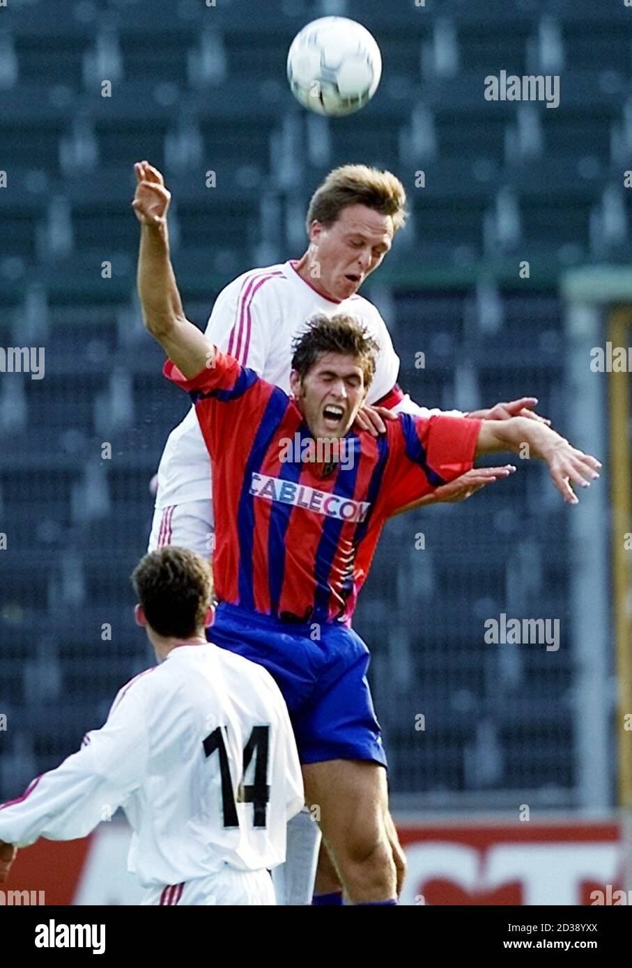 Feliciano Magro (C) of FC Basel and Egli Ulfstein (C above) of Norway's SK Brann Bergen jump for the ball as Sergei Terehhov (L) looks on during the UEFA Cup first round first leg match FC Basel vs. SK Brann Bergen in Zurich, Switzerland, September 12, 2000.  SIB/HM/JRE Stock Photo