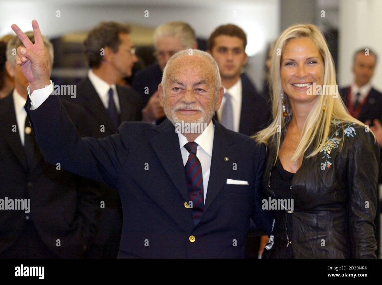 Italian producer Dino De Laurentiis and his wife Martha arrive at the Venice Film Festival September 1, 2003. De Laurentiis received the Golden Lion lifetime achievment award . Stock Photo