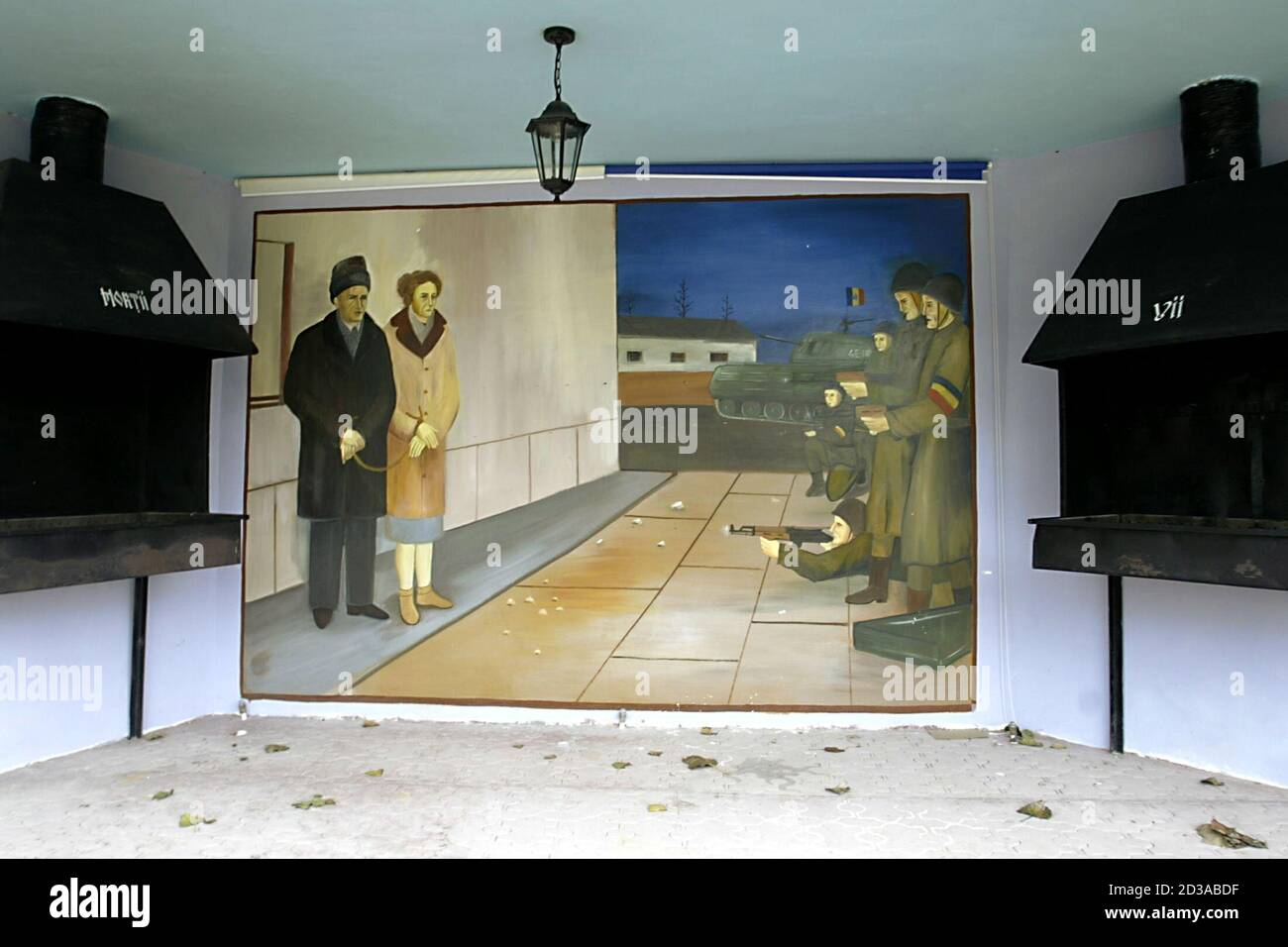 - PHOTO TAKEN 10NOV04 - The scene of the execution of Romania's late Stalinist dictator Nicolae Ceausescu and his wife Elena is painted on a wall in a private park dedicated to the country's communist past near Craiova (250km west of Bucharest) in this November 10 file picture. Many in the impoverished countryside are nostalgic of Ceausescu ahead of Sunday's elections, saying they miss the job security they enjoyed during his time, and are expected to back the ruling socialists, successors of his communist party. Stock Photo