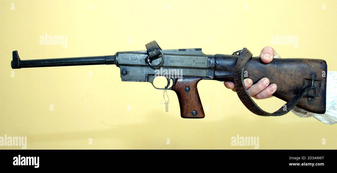 The French-made MAS sub-machine gun that killed Italy's Benito Mussolini in 1945 is pictured in Tirana August 4, 2004. [For the past 47 years it has lain in the obscurity of a Tirana museum, gifted to Albania's Stalinist leaders by the man who pulled the trigger on Il Duce and his clinging lover.] Stock Photo