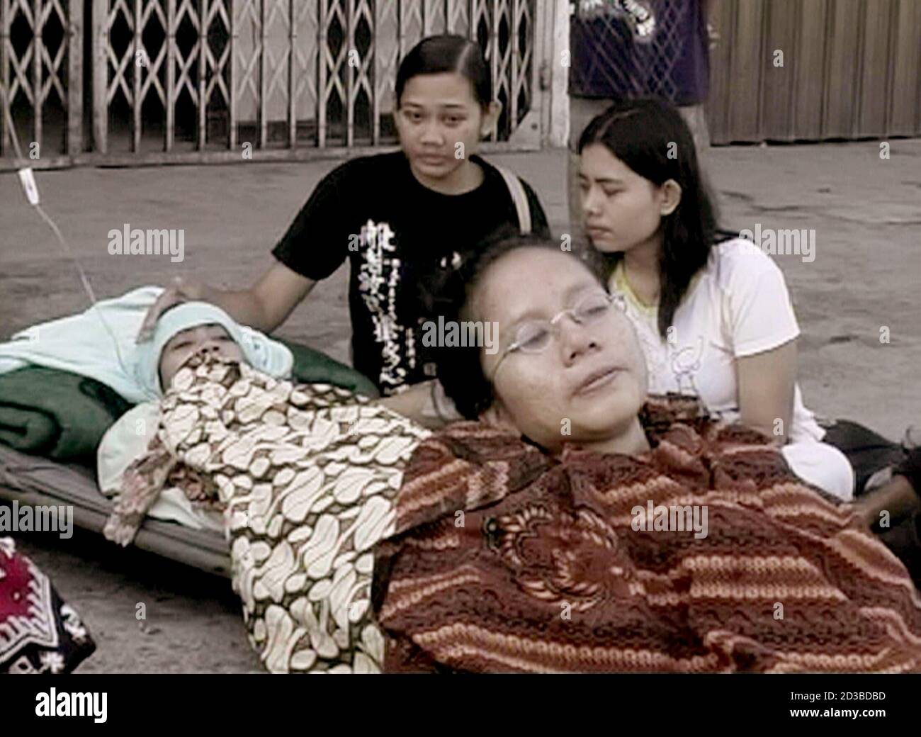 An Image Made Available On February 1 2005 Taken From Television Footage Shows Acehnese In Need Of Medical Attention Following The Devastating Earthquake On December 26 2004 In Banda Aceh And Before